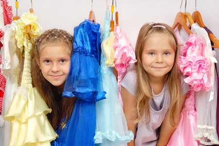 Little girls in shop of dresses Stock Photo