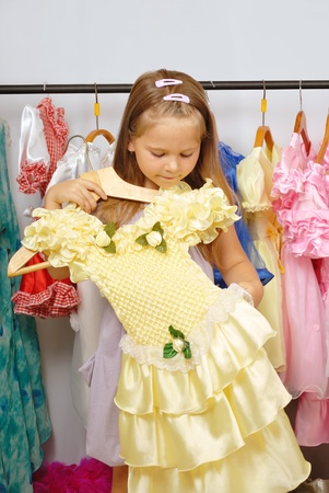 Little girl in shop of dresses