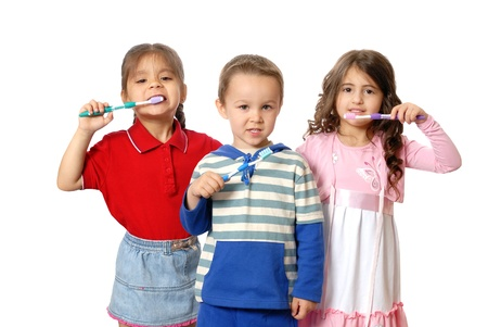 Children with tooth-brushes. Isolated on white
