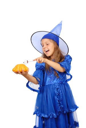 Young witch with a magic wand and pumpkin isolated on the white  Stock Photo