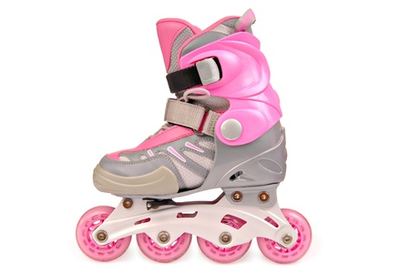 Childrens roller skates. Isolated on the white photo