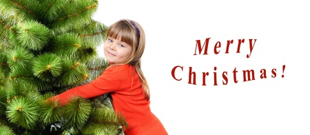 Girl embraces a green pine on white background  Greetings card photo