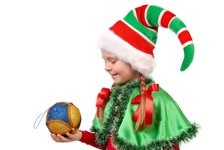 Girl in suit Santa s elf with a Christmas ball  Isolated on a white