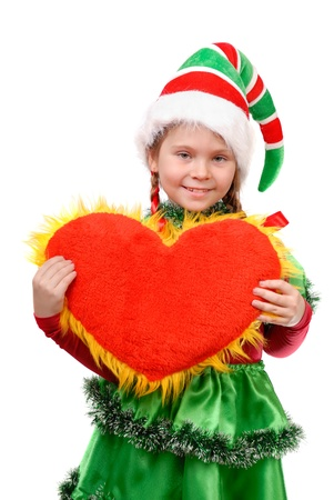 Girl in suit Santa s elf holds heart   Isolated on the white background