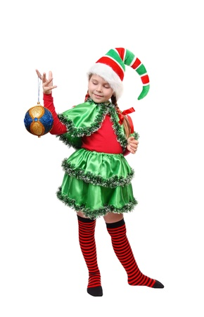 Santa s elf with a Christmas ball  Isolated on a white Stock Photo