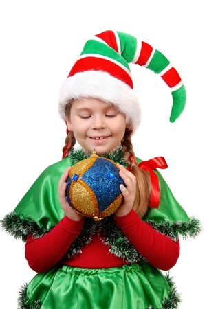 Girl in suit of Santa s elf with a Christmas ball  Isolated on a white