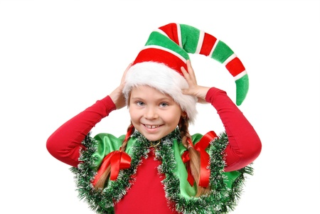 Portrait of the girl in a dress of elf Santa  Isolated on a white Stock Photo