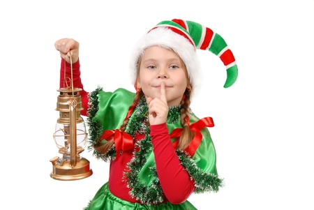 Girl in suit of Christmas elf with oil lamp with finger over her mouth  Isolated on a white