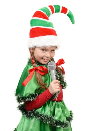 Girl - Santa s elf with a microphone  Isolated on a white