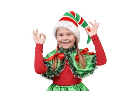 geste: Girl - Santa s elf showing sign OK  Isolated on the white background