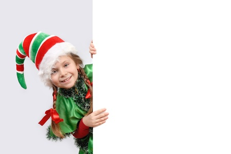 Little girl in suit of Christmas elf with the white board