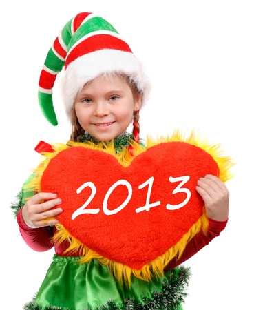 Girl - christmas elf holds heart  2013 write on heart   Isolated on the white background Stock Photo - 16828829