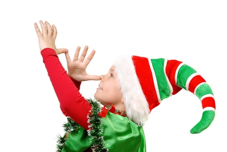 Girl in a dress of the Christmas elf  Isolated on a white background