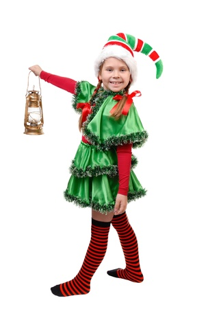 Girl in suit of Christmas elf with oil lamp  Isolated on a white background