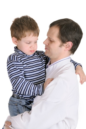 Doctor holds on hands of the little boy  Isolated on white Stock Photo