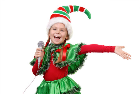 Girl in suit of Christmas elf with microphone