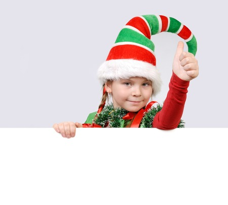 geste: Girl - Santas elf showing sign OK with the banner Stock Photo