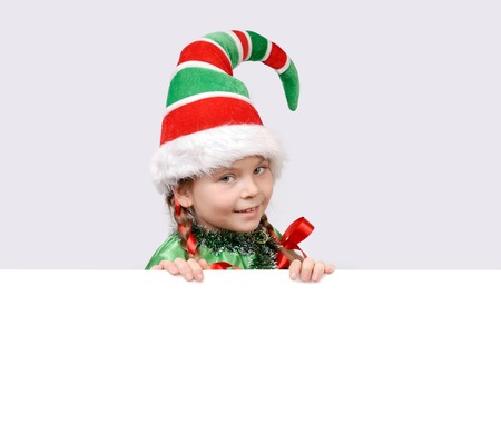 Girl in suit of Christmas elf with the white banner Stock Photo