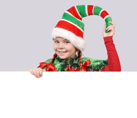 Girl in suit of Christmas elf with the white board photo