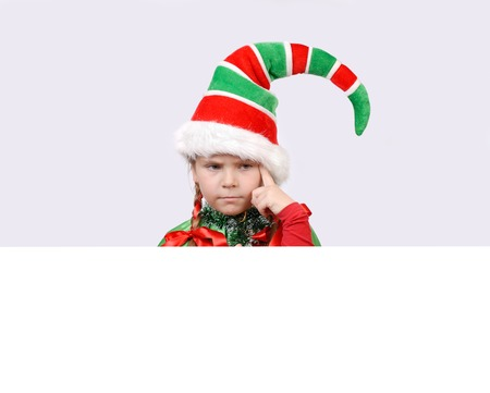 Girl in suit of Christmas elf with the white banner photo