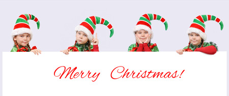 Four girls in suits of Christmas elf with white banner