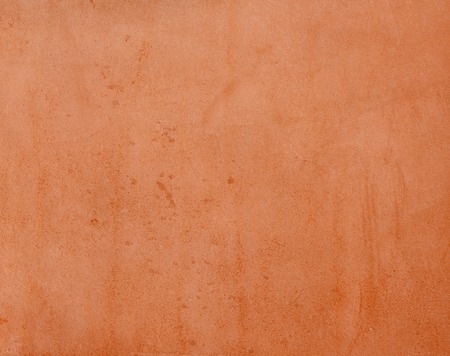 rudy: Texture  vegetable tanned leather reddish color.