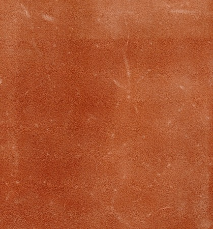 rudy: Texture of a bakhtarma of skin of a vegetable tanning of reddish color. Stock Photo