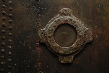 illuminator: Window on a rusty metal wall. Steampunk style