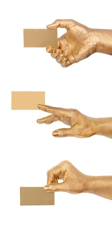 debet: Mans golden hand holding an empty business card over white background. Set from 3 gesture for your business projects. Stock Photo