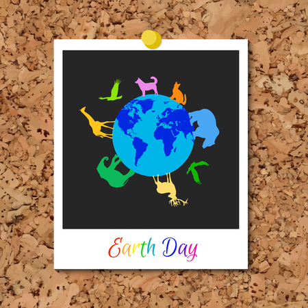 cork board with instant photo card and multi color animals silhouettes around blue planet Earth. World Environment Day holiday. Dog, cat, deer, eagle, bear, elephant, giraffe silhouettes.