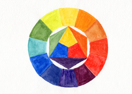 mixed colors: Color wheel. Watercolor handdrawn wheel over white. Primary colors in the center and resulting mixed colors in the circle.