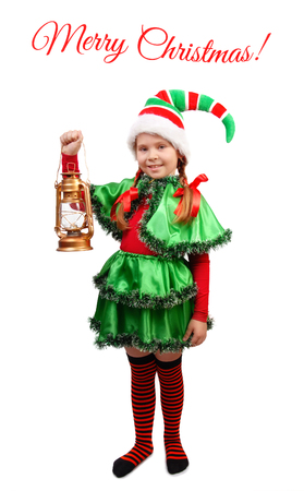 Girl in suit of Christmas Elf with Oil Lamp. Isolated on a white background