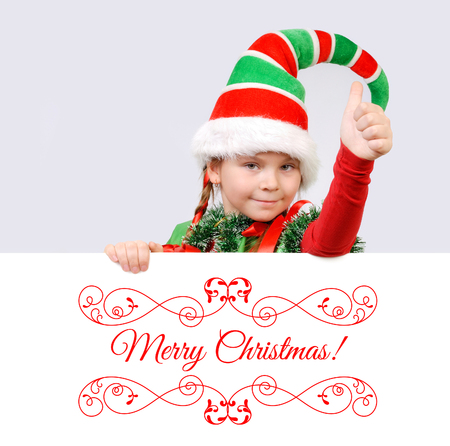 geste: Girl Santas elf showing sign OK with the banner. Background for your Merry Christmas and Happy New Year projects. Stock Photo