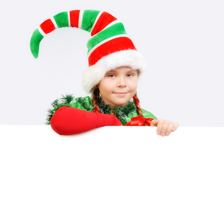 Girl Santas elf with the white banner.
