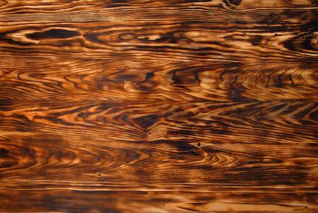 Background texture from burned brown pine wood