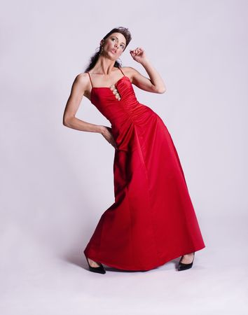 red evening: Young woman wearing a long red evening gown