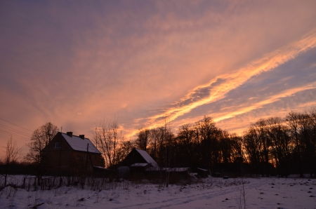 Winter sunset in the village photo