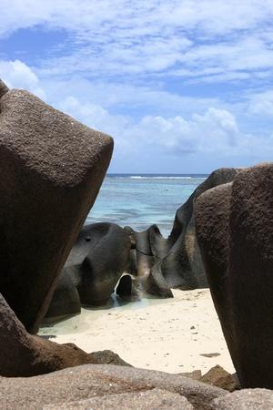 d argent: rock beach in Seychelles