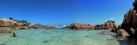 d argent: natural pool in a blue lagoon beach seychelles