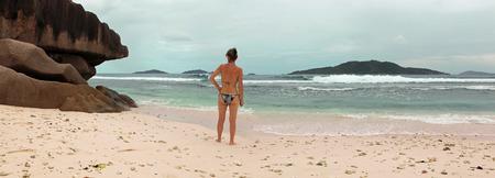 woman on beach of Seychelles Stock Photo