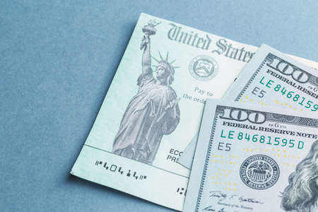 A US stimulus check with some hundred dollar bills