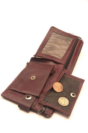 joblessness: Old  ragged purse wit one cent coin. Symbol of poverty and financial crash