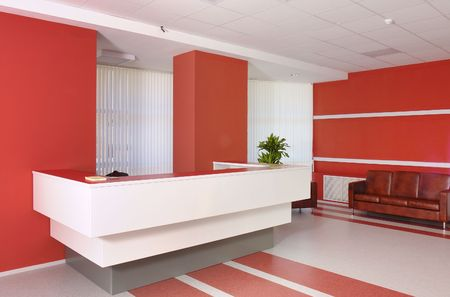 Business office recepcion in wihte and red colors