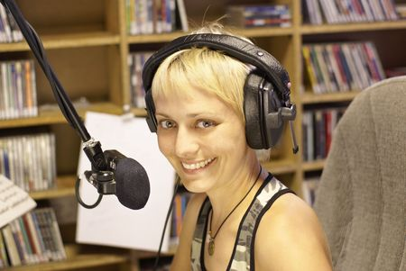 radio station: Young girl as announcer and dj at small broadcasting station