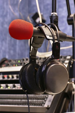 shure: Microphone with head phones in broadcasting station   Stock Photo