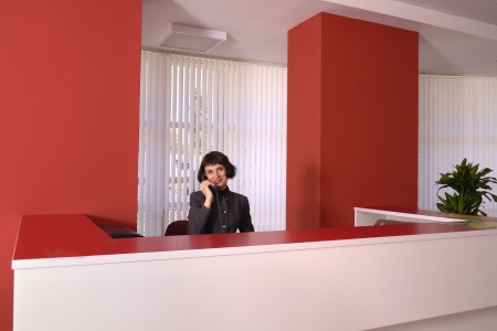 hotel receptionist: Business office recepcion in wihte and red colors