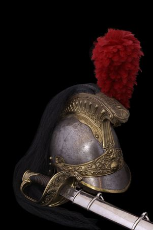 infantry: Composition with saber (sabre, cavalry sword) of French infantry officer (model 1855) and French cuirassier helmet (1836). Path on dark background.                   Stock Photo