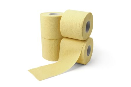 roll of yellow toilet paper isolated on white background photo