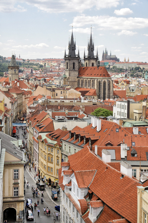steeples: View from Powder Gate to the Church of Our Lady before Tn. The churchs Gothic steeples arethe Old Towns most distinctive landmark. Astronomer and astrologer Tycho Brahe is buried in Tn Church. On the right background is the Prague Castle. Editorial