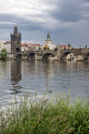 The famous Charles Bridge The Old Town Bridge Tower started in 1357 under the auspices of King Charles IV, and finished in the beginning of the 15th century.The Old Town Bridge Tower left dates from 1380. The Gothic sculptural decoration on the eastern fa